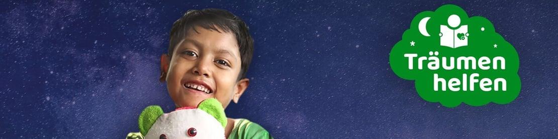 """Kind mit Teddy und Logo von """"Träumen helfen"""""""