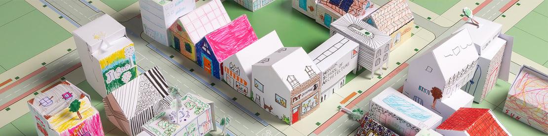 Papiersiedlung, die in Zusammenarbeit von Kindern und Foster + Partners entstanden ist.